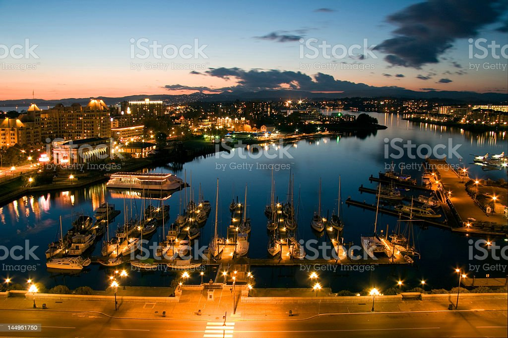 Aerial view of illuminated dock and waters stock photo