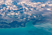 Aerial view of island and clouds