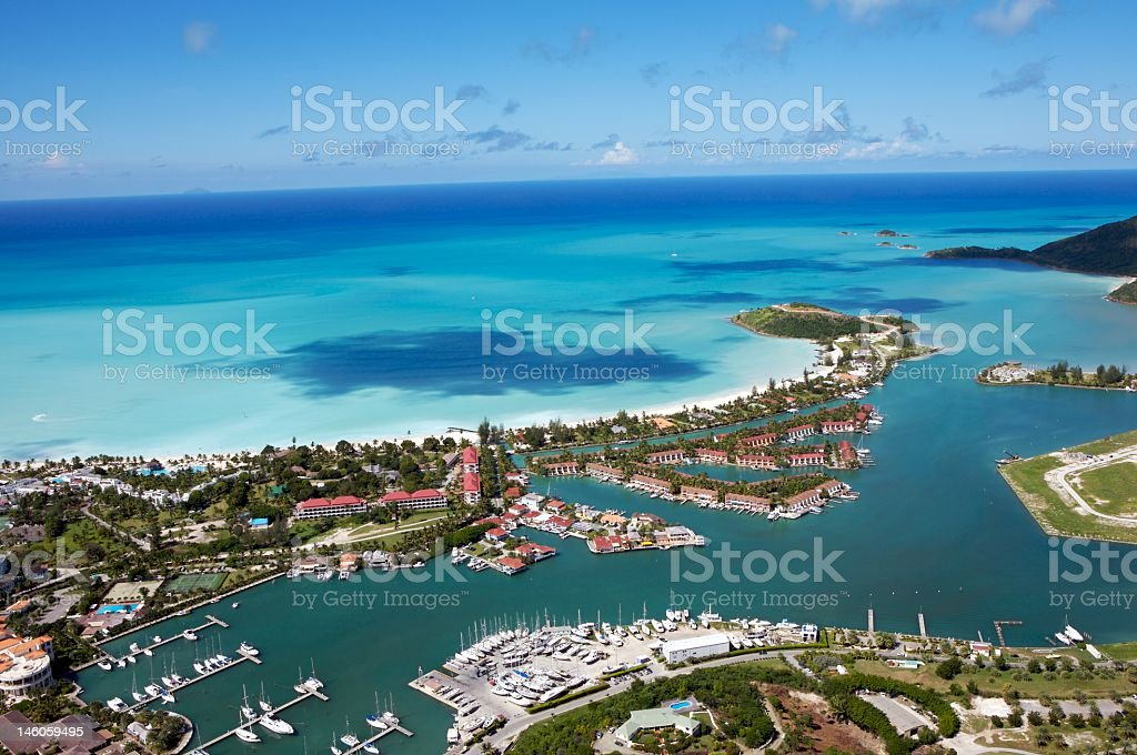 Aerial view of Jolly Harbour with sea meeting sky on horizon stock photo