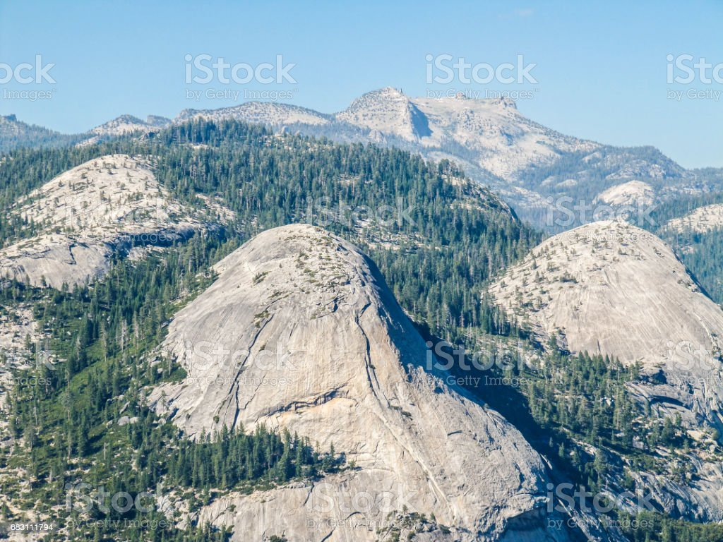 Aerial view of landscape during summer in Yosemite National Park with many pine trees and mountains stock photo