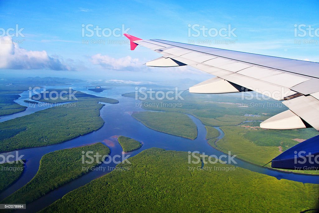 Aerial view of landscape with plane wing at Krabi, Thailand stock photo