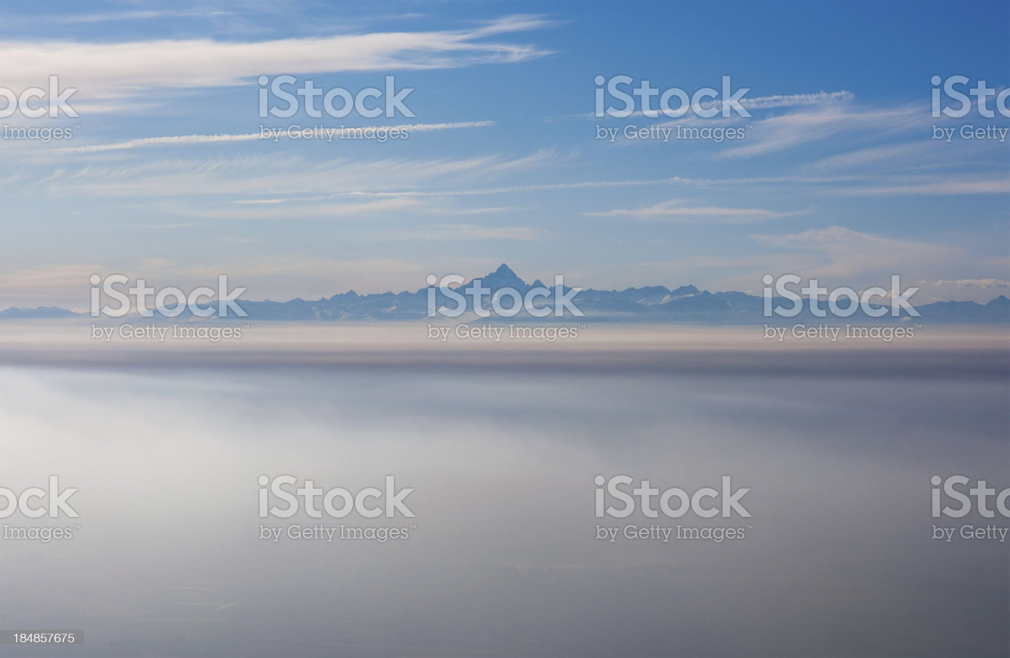 Aerial view of Monviso, clouds around, from Turin view royalty-free stock photo