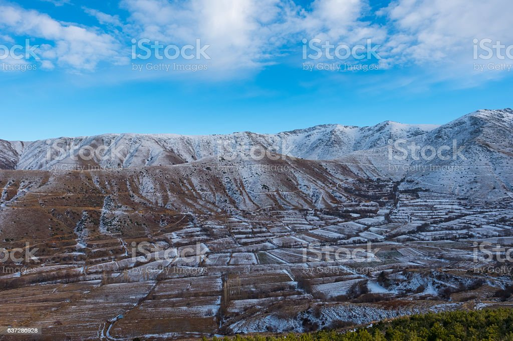 Aerial view of mountains and fields covered with snow stock photo