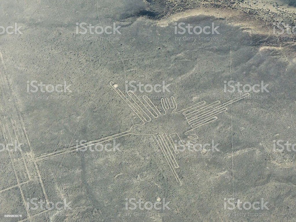 Aerial view of Nazca Lines - Hummingbird geoglyph, Peru. stock photo