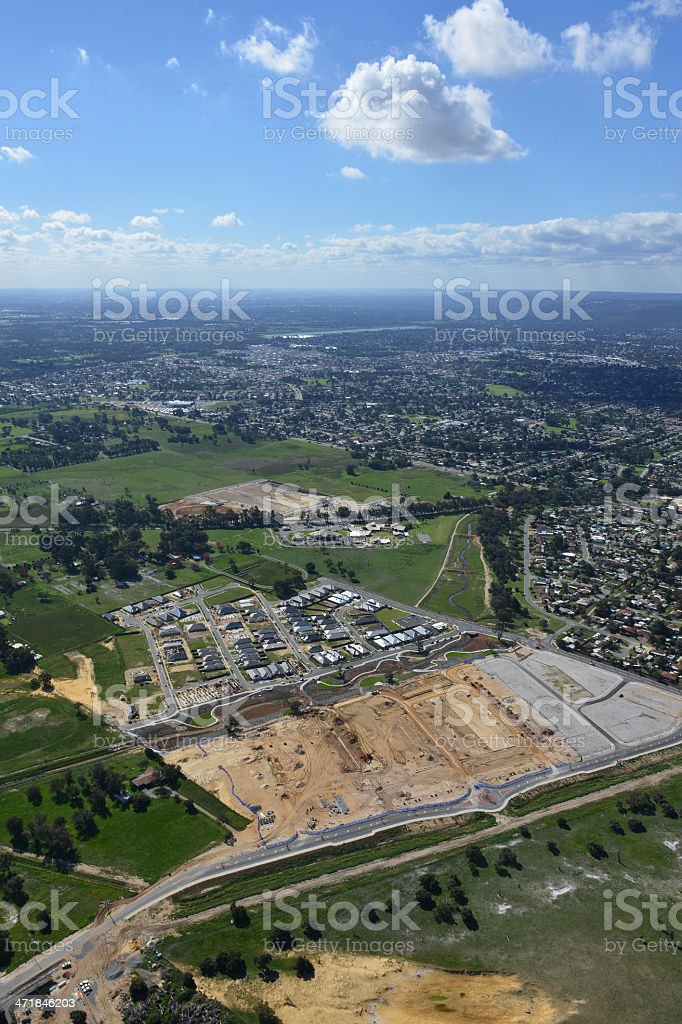 Aerial view of new urbanisation into existing farmland. stock photo