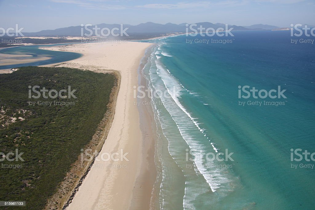 Aerial view of ocean waves and beach stock photo