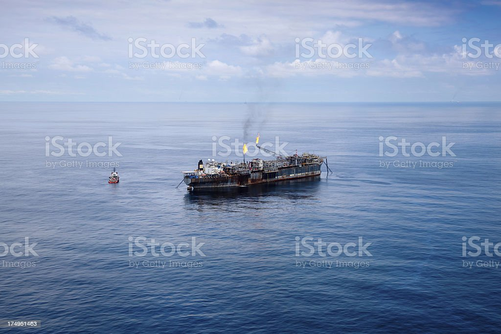 Aerial view of old FPSO oil rig in middle of ocean stock photo