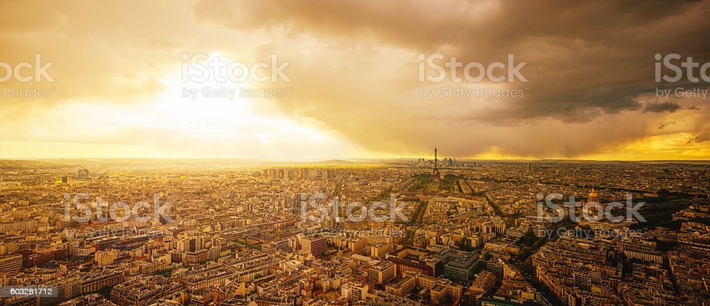 Aerial View of Paris at Sunset with Dramatic Storm Clouds stock photo