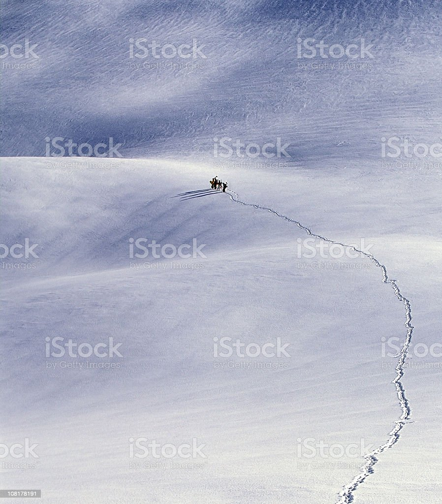 Aerial View of People Trekking Through Snow royalty-free stock photo