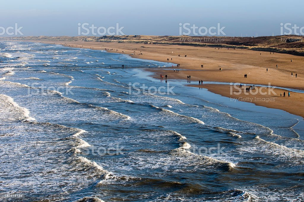 Aerial view of people walking along the Dutch coast royalty-free stock photo