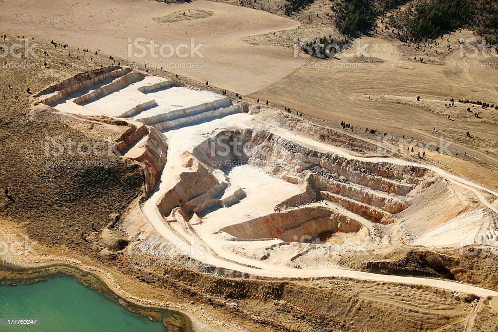 Aerial view of phosphate mine near water stock photo