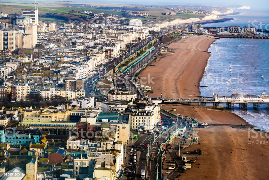 Aerial view of pier and Brighton beach and seafront, Brighton, UK stock photo