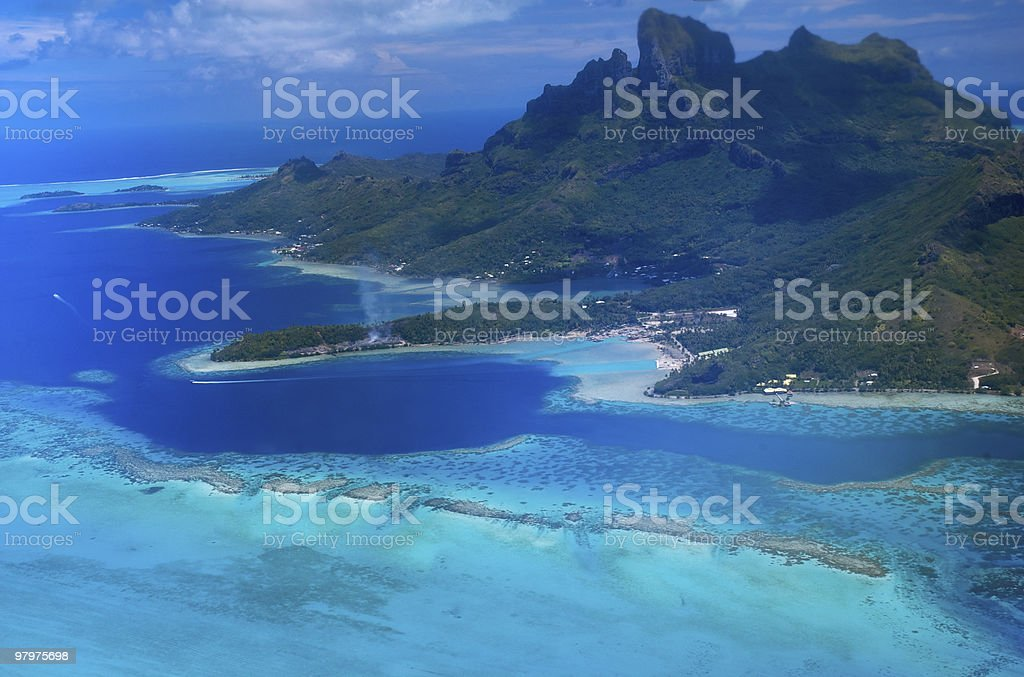 Aerial view of Polynesia islands and pristine blue ocean royalty-free stock photo