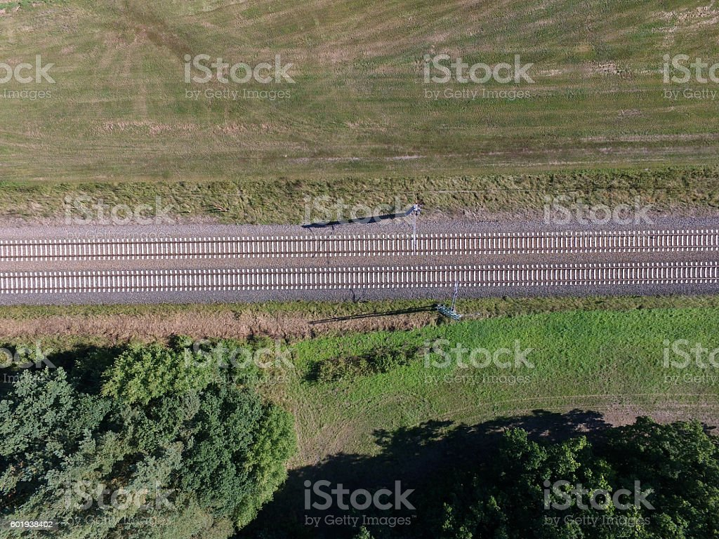aerial view of railroad track in the country with forest stock photo