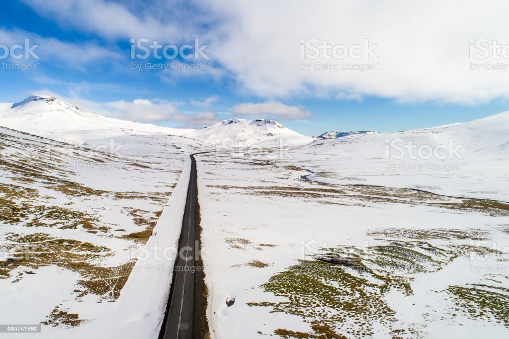 Aerial view of road and snowy mountains, Iceland stock photo