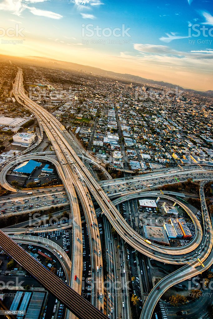 Aerial view of road interchanges at dusk stock photo