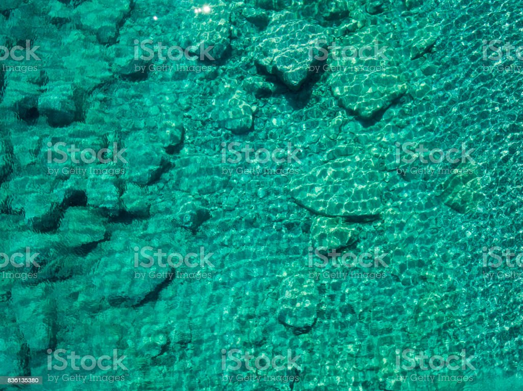 Aerial view of rocks on the sea. Overview of the seabed seen from above, transparent water stock photo
