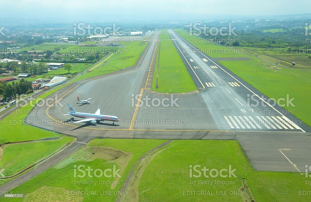 Aerial view of runway and plane stock photo