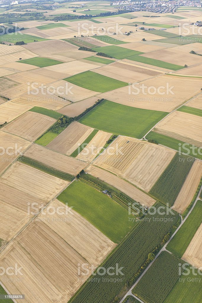 Aerial view of rural landscape with green and yellow fields royalty-free stock photo