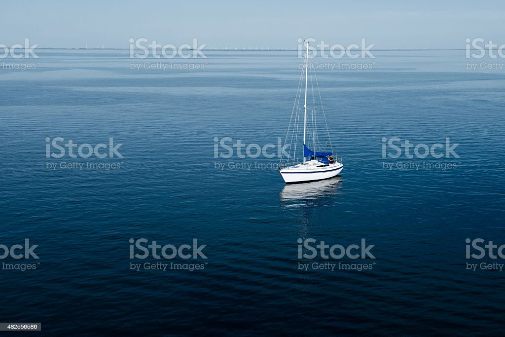 Aerial View of Sail Boat on Ocean stock photo
