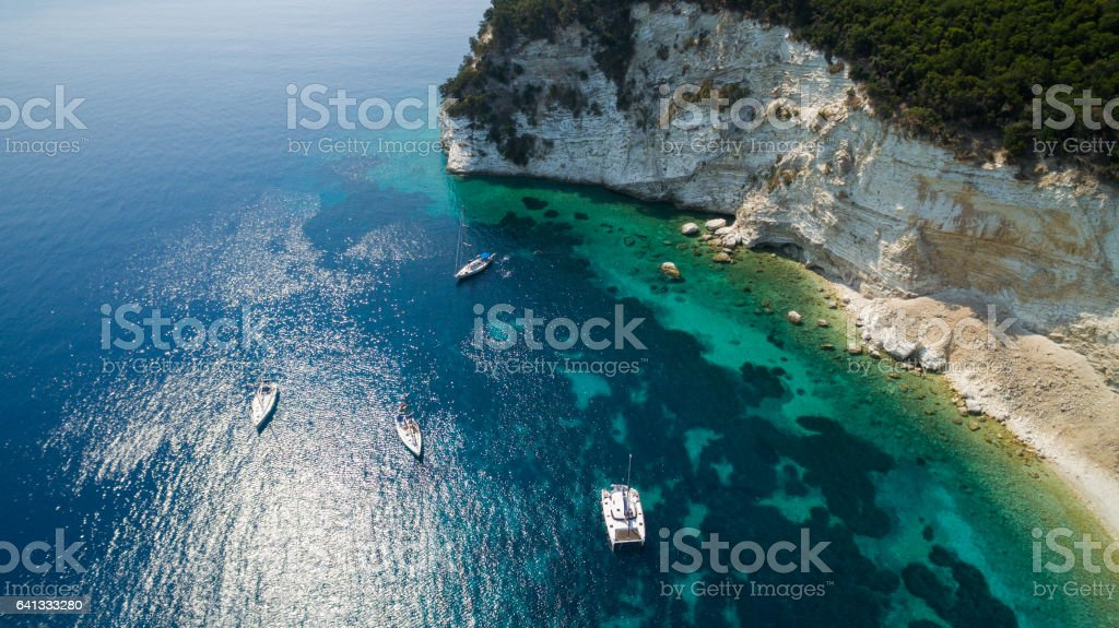 Aerial view of sailboats in bay stock photo