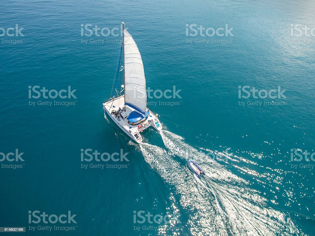 Aerial view of sailing boats walking on the sea stock photo