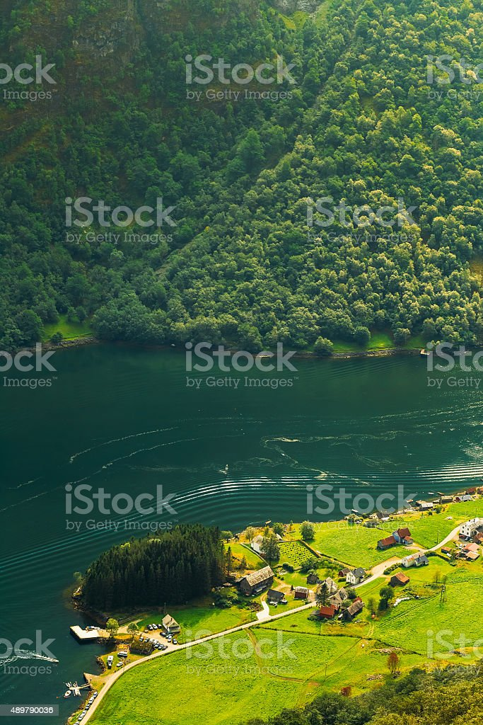 Aerial view of Scandinavian village on the shore of  Naeroyfjord. stock photo