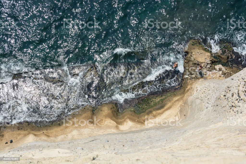 Aerial view of sea and a stone wall stock photo
