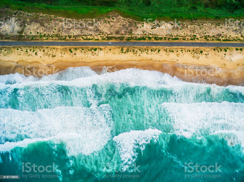 Aerial view of sea waves and beach stock photo