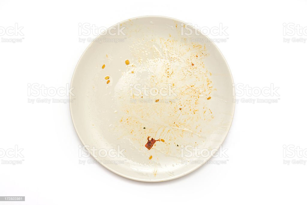 Aerial view of single dirty white dish on white background stock photo