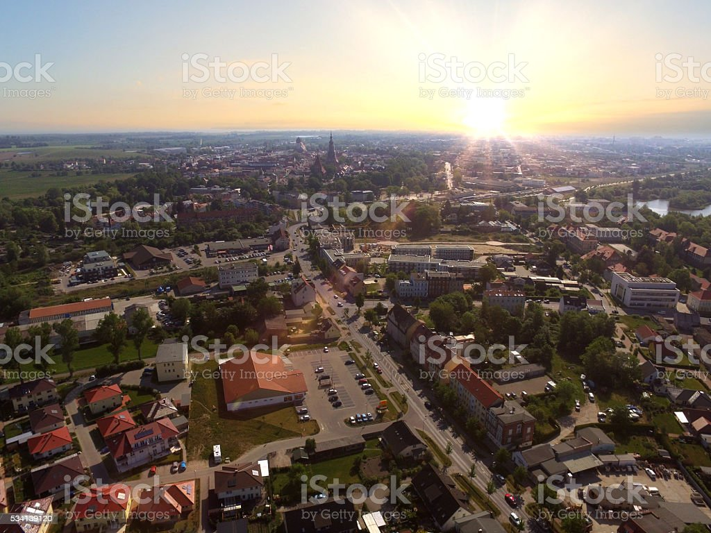 aerial view of small city buildings in the sunset stock photo