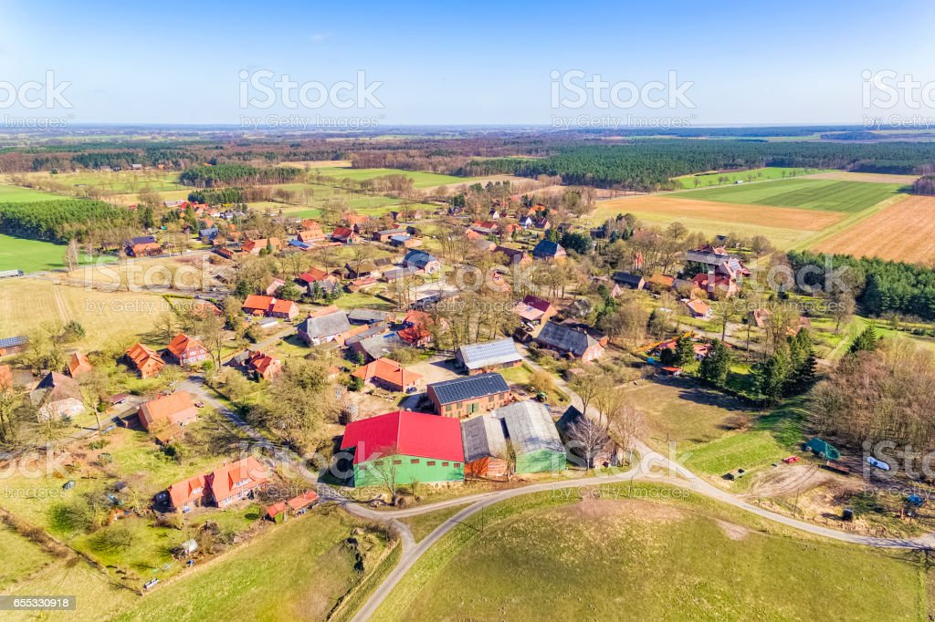 Aerial view of small village and agricultural land in Germany / Splietau Lüchow Dannenberg Lower Saxony stock photo