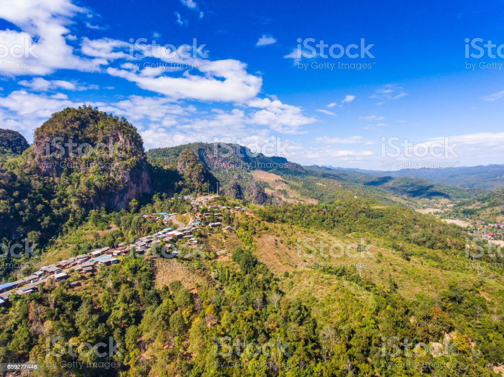 Aerial view of small village on green mountain stock photo