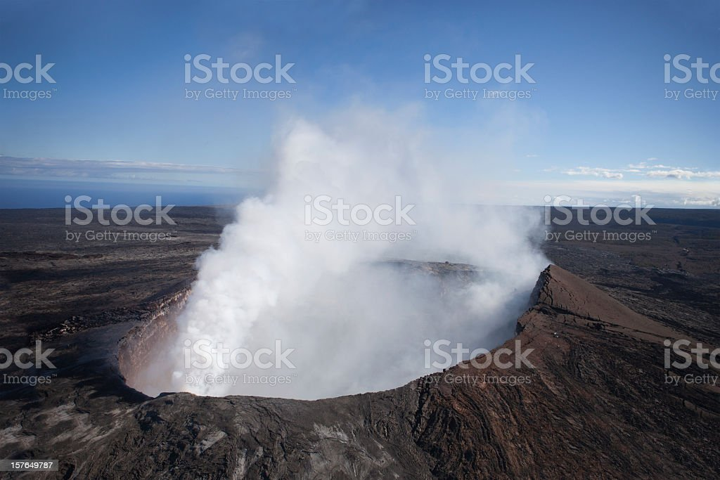Aerial view of smoking volcano in Hawaii royalty-free stock photo