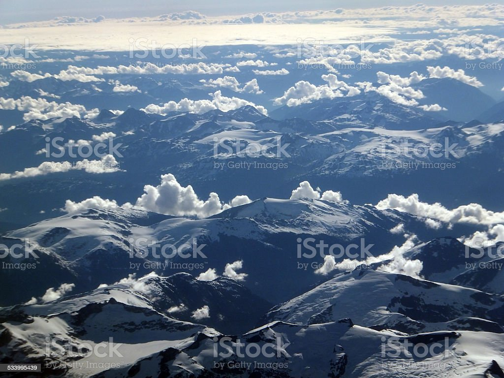 Aerial view of snow covered mountains in Canada stock photo
