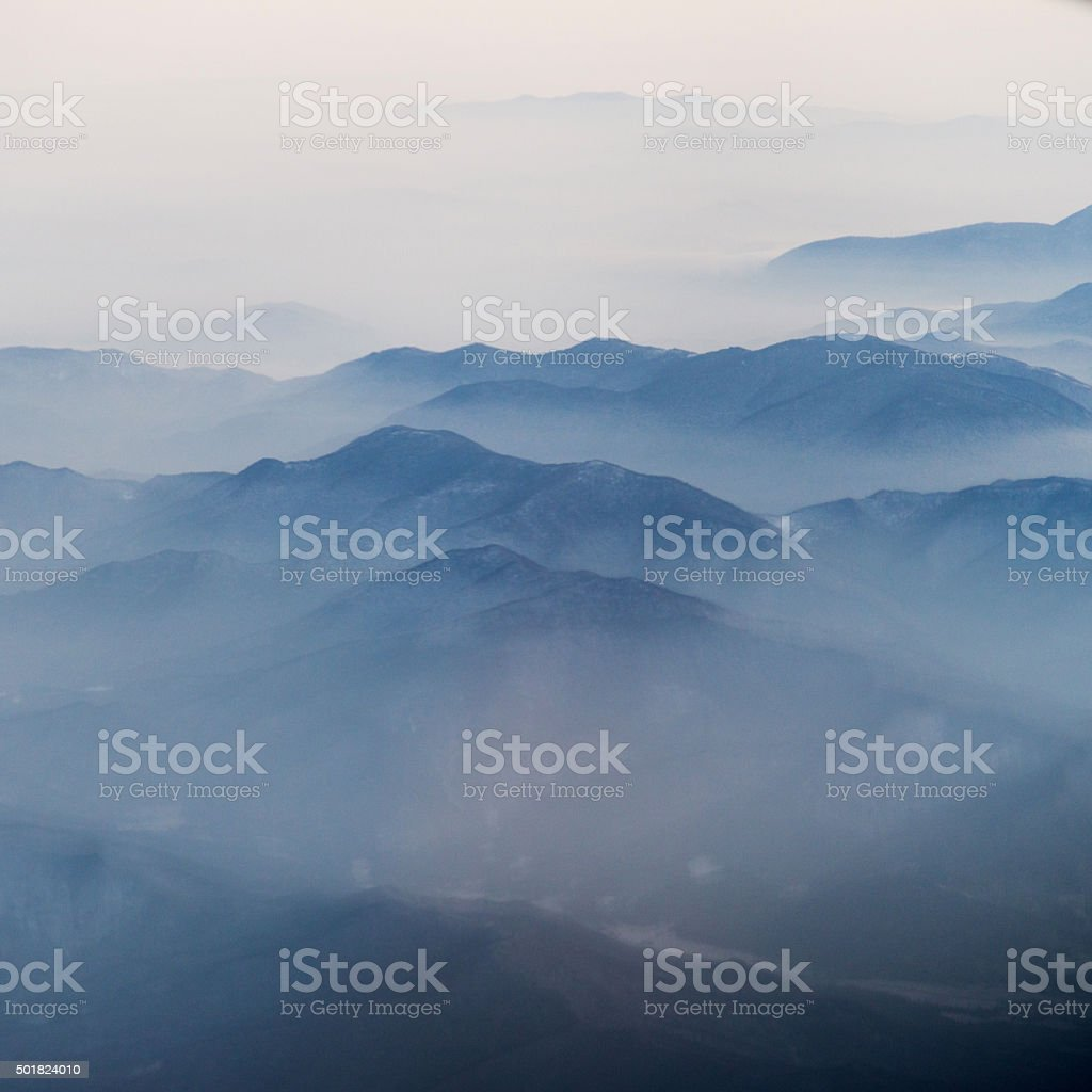 Aerial view of snow mountains stock photo
