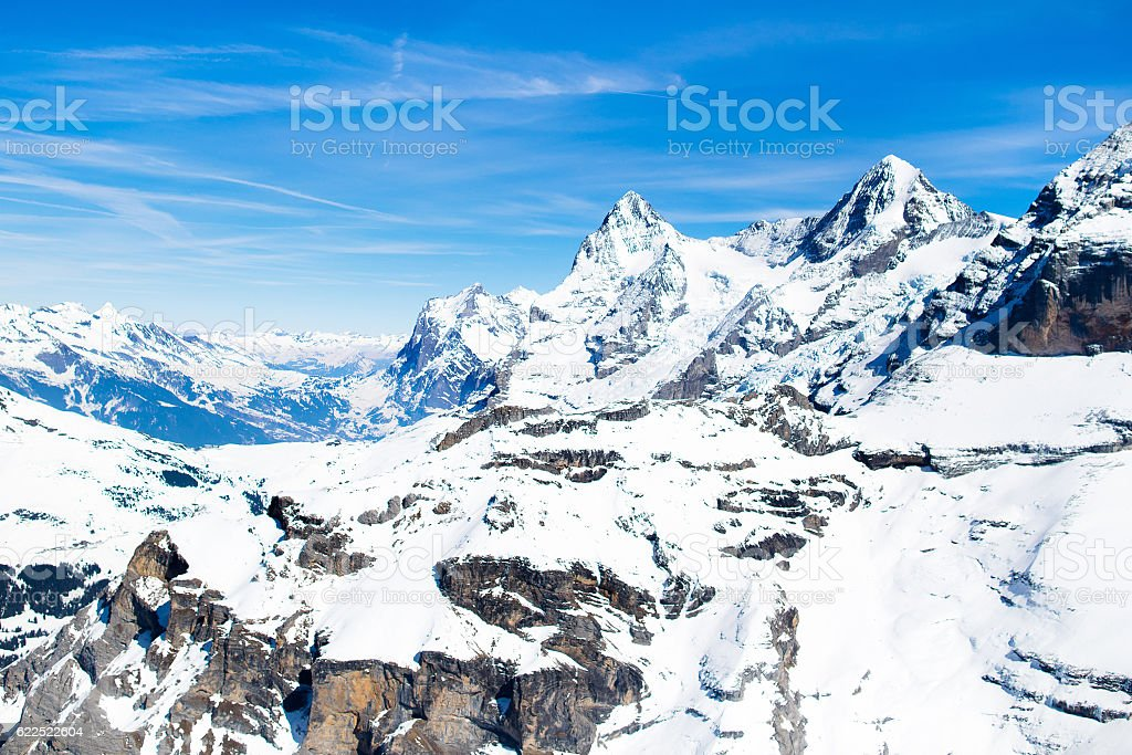 Aerial view of Swiss Alps. Mountain tops covered in snow. stock photo