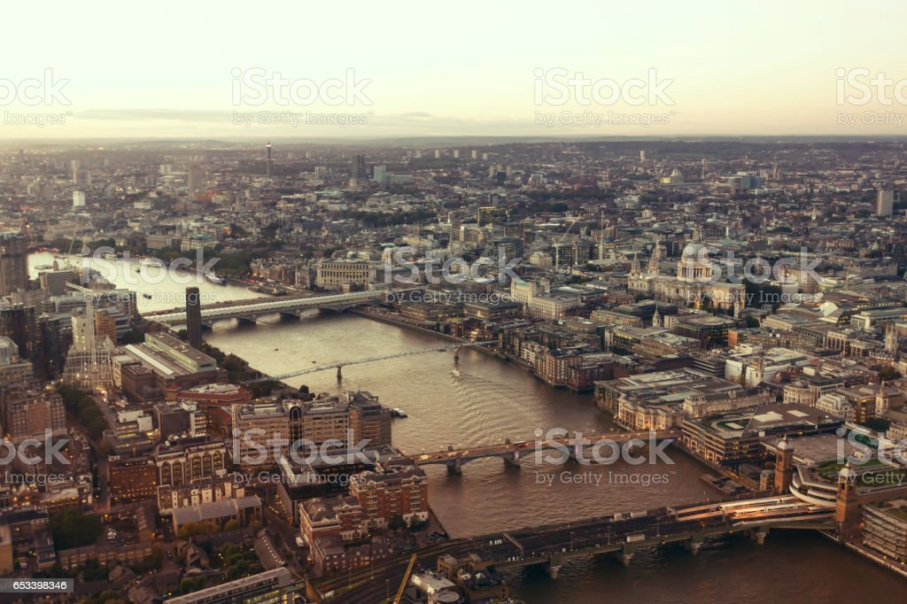 Aerial view of Thames bridges and the City of London at twilight stock photo