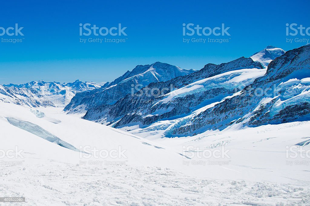 Aerial view of the Alps mountains in snow in Switzerland stock photo