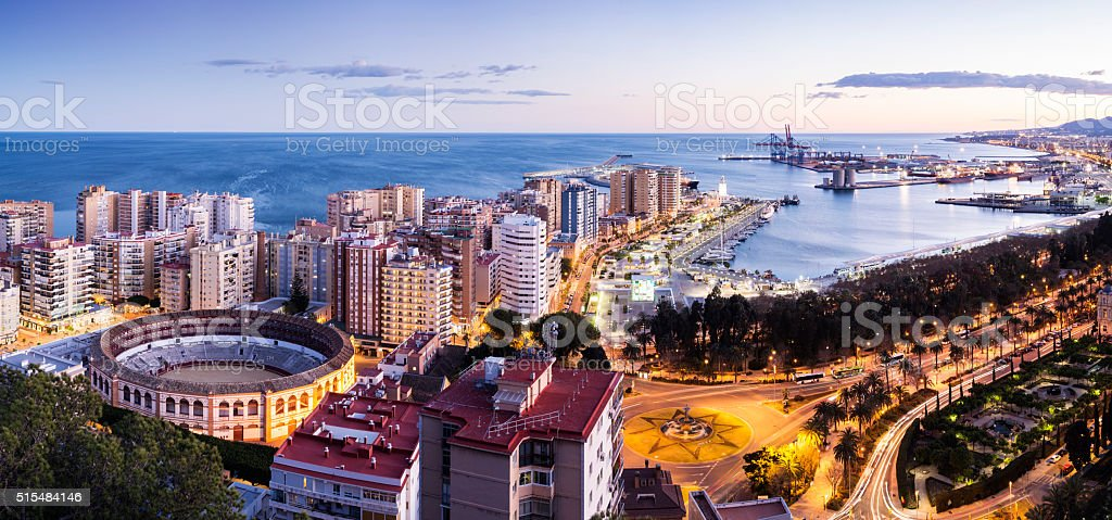 Aerial view of the city of Malaga at sunset Spain stock photo