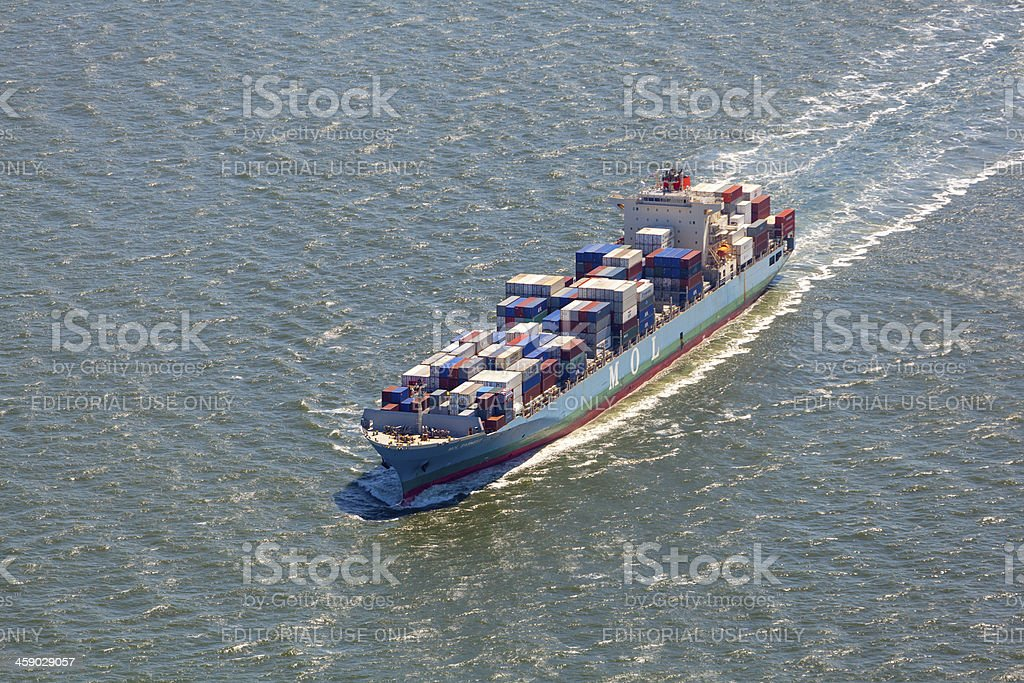 Aerial view of the MOL Earnest leaving Rotterdam harbour. stock photo