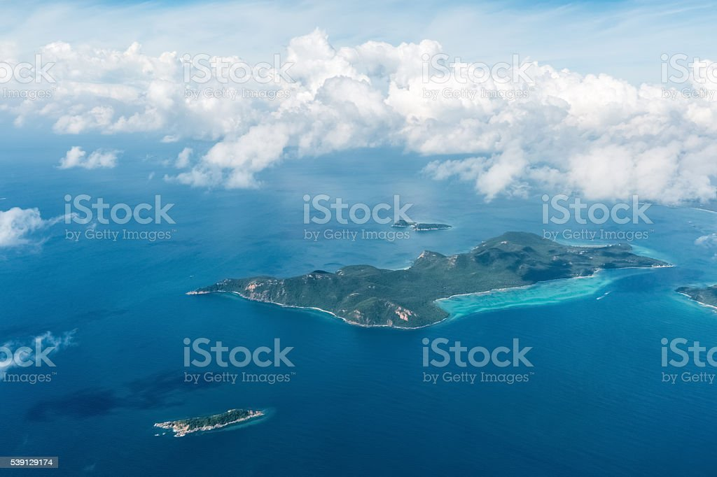 aerial view of the sea island and clouds stock photo