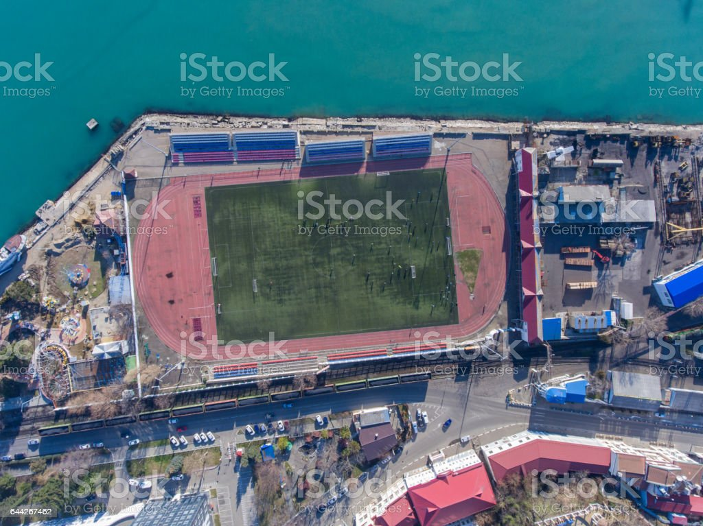 Aerial view of the stadium in the port area by the sea stock photo