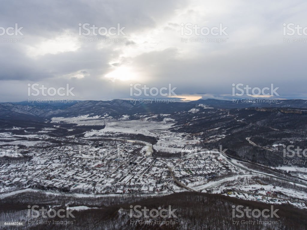 Aerial view of the village in the valley. Winter landscape stock photo