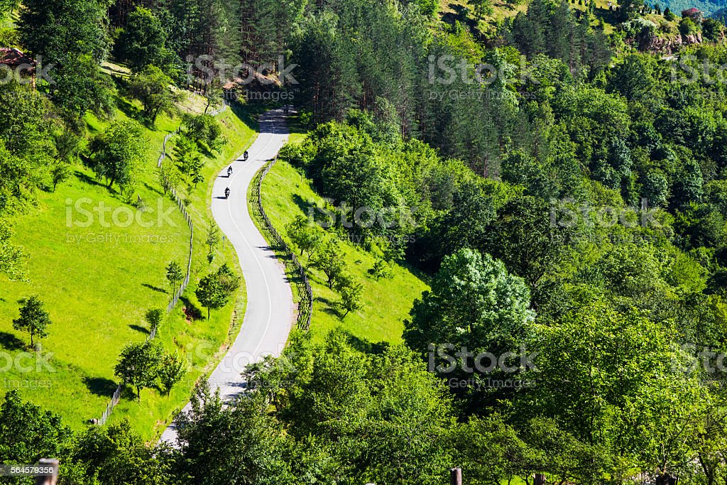Aerial view of three motorcyclists on a rural road stock photo