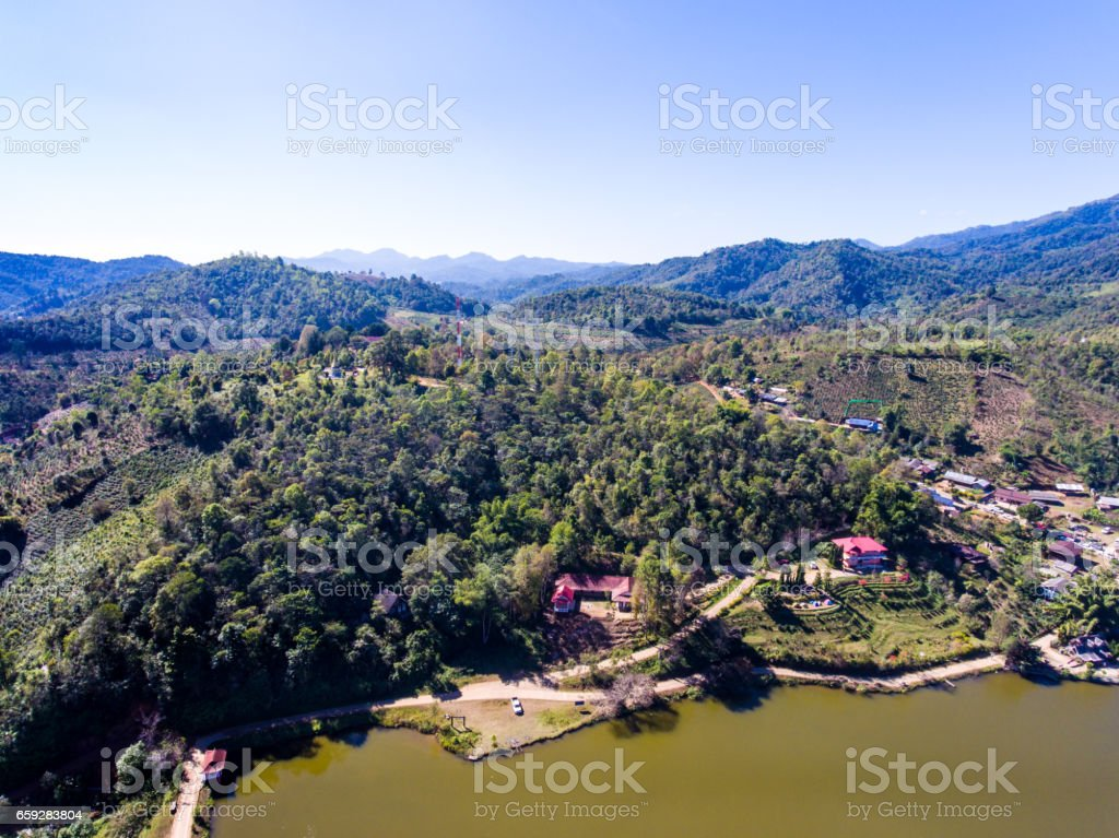 Aerial view of  Tribe vollage and lake on the mountain stock photo