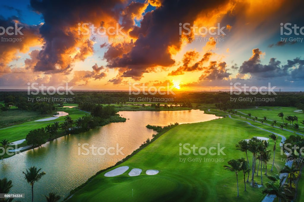 Aerial view of tropical golf course at sunset, Dominican Republic, Punta Cana stock photo