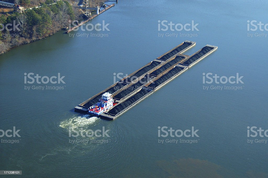 Aerial view of Tug and barges carrying coal stock photo