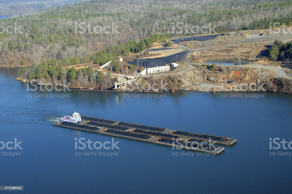 Aerial view of Tug and barges carrying coal royalty-free stock photo
