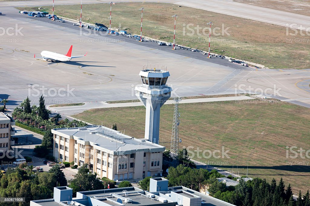 aerial view of two airplanes on ground near the tower stock photo